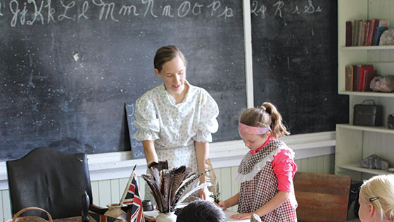 old schoolhouse teacher with young child