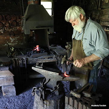 blacksmith in his shop