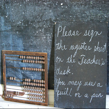 Abacus and an old sign on the chalk board