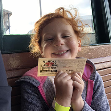 young smiling girl with visitor pass