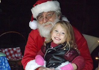 Santa with smiling little girl